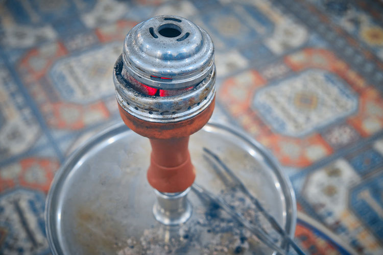 Close-up of hookah on table