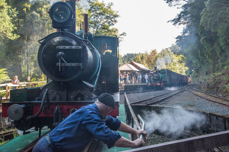 Jan 2017 - Queenstown Cog Train, Queenstown, Tasmania 18th Century Turntable Day Locomotive Men Mode Of Transportation Motion Nature One Person Outdoors Rail Transportation Railroad Track Steam Locomotive Steam Train Track Train Train - Vehicle Transportation Tree