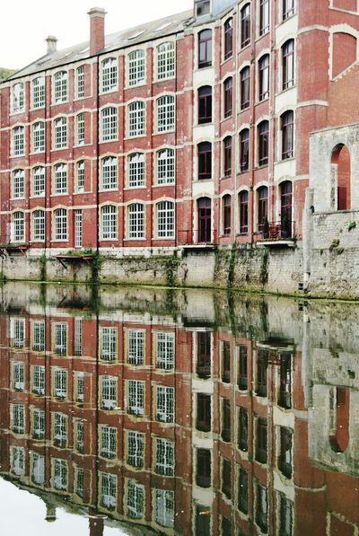 Reflections Building Exterior Architecture Built Structure Window Residential Building Apartment City Outdoors No People Day Canal Scenics Apartments Old Industry Converted Building Towpath Photography Façade Architecture Waterway Flats Canal View Waterside Building Reflection