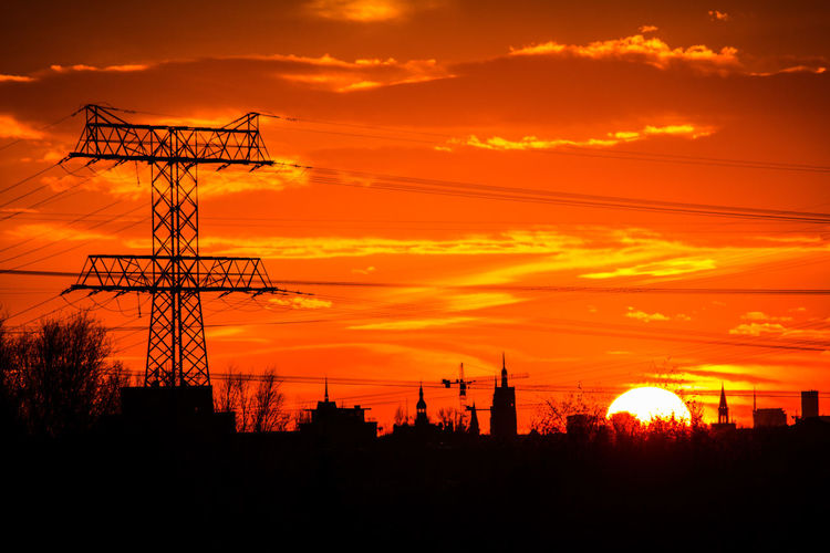 Sunset Sky Orange Color Silhouette Technology Cloud - Sky Architecture Nature Electricity  Cable Fuel And Power Generation Industry Low Angle View No People Power Supply Electricity Pylon Built Structure Machinery Connection Power Line  Outdoors Construction Equipment