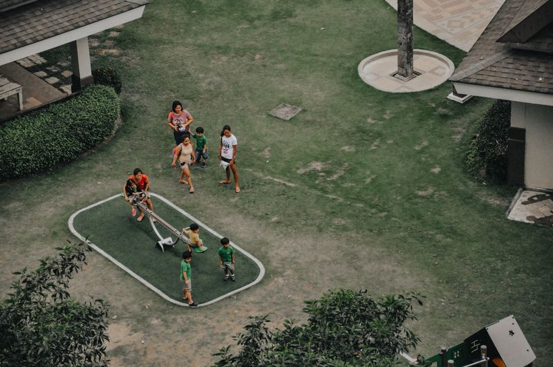High angle view of people playing on the floor