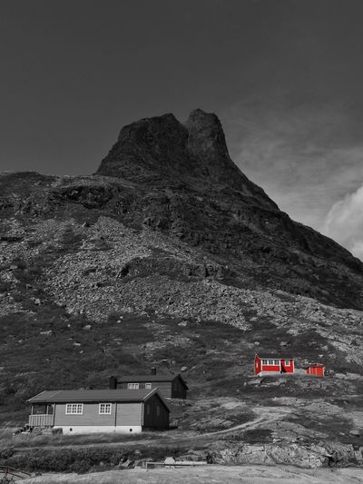 Norway Architecture Beauty In Nature Black And Red Colour Building Building Exterior Built Structure Cottage Day Formation House Land Landscape Mode Of Transportation Mountain Mountain Peak Mountain Range Nature No People Non-urban Scene Outdoors Red House Rock Scenics - Nature Sky Transportation