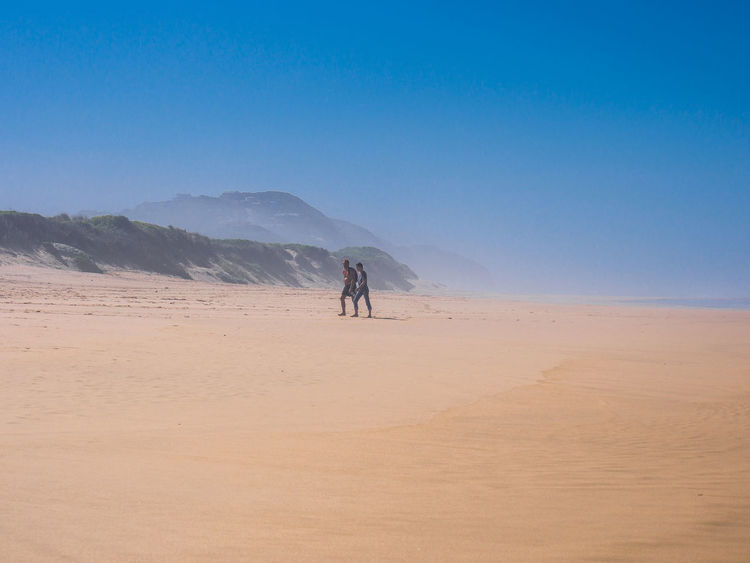 Beach Beauty In Nature Clear Sky Day Landscape Men Outdoors People Real People Sand Sand Dune Sky Togetherness Two People Walking