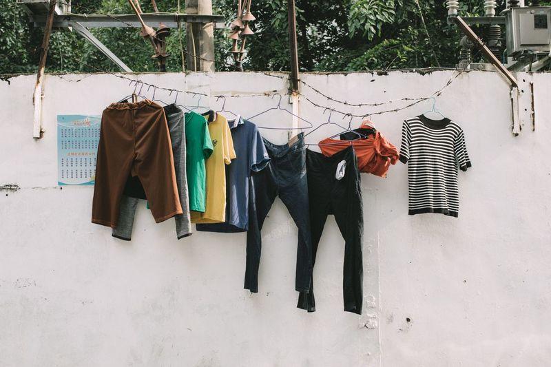 无题 Hanging Clothing No People Drying Day Nature Choice Variation Textile Clothesline Side By Side Outdoors Laundry Coathanger Group Of Objects Medium Group Of Objects Shadow Sunlight In A Row Wall