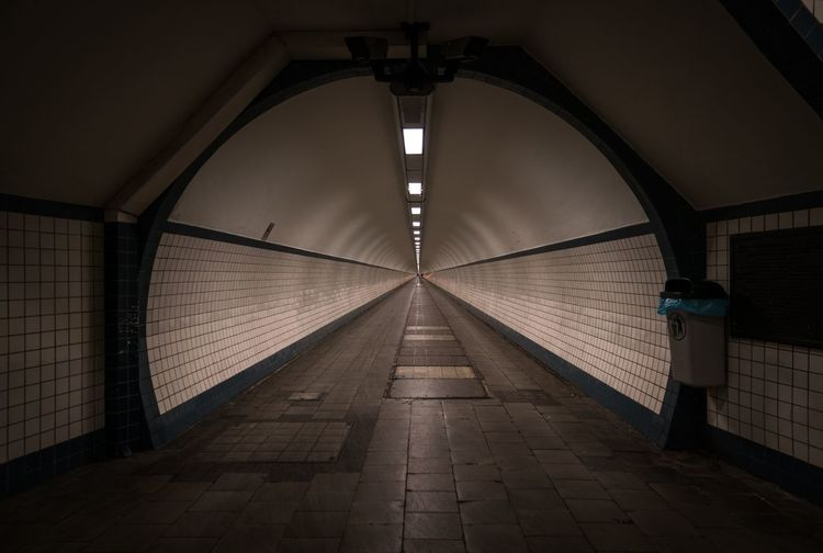 Interior Of Empty Illuminated Tunnel