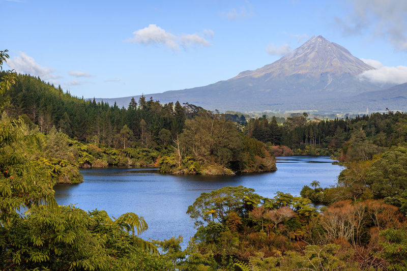 Small lake with Mount Tranaki in the background Mountain Water Scenics - Nature Beauty In Nature Tranquil Scene Plant Tree Sky Tranquility Lake Nature No People Growth Day Non-urban Scene Cloud - Sky Idyllic Environment Landscape Outdoors Mountain Peak Snowcapped Mountain Egmont National Park Mount Taranaki New Plymouth New Zealand New Zealand Scenery New Zealand Beauty New Zealand Landscape Mountain View Forest Forest Photography Autumn Daylight Lake View Lake Shore Blue Sky Blue Water Plants Leaves