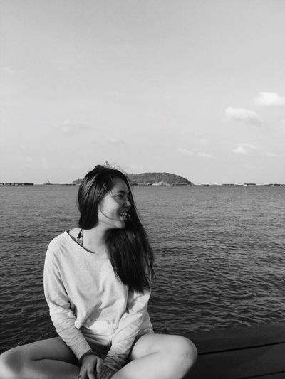 Smile! Sea One Person Beach Real People Sitting Water One Young Woman Only Happiness Blackandwhite Lifestyles On A Holiday EyeEm Selects