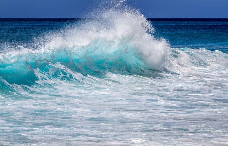 Waves breaking against sea
