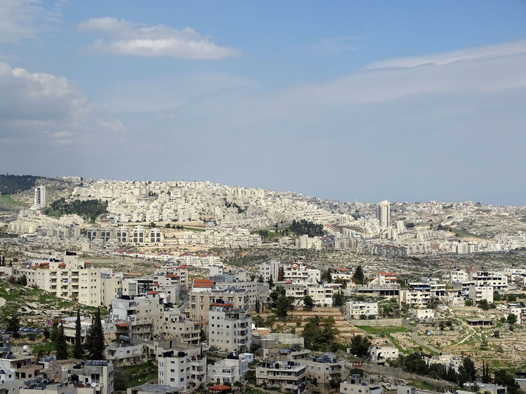 Bethlehem in Palestinean Territories with settlement Architecture Building Exterior Built Structure City Cityscape Cloud - Sky Community Day Nature No People Outdoors Residential Building Residential District Sky Travel Destinations Tree Jewish Settlement Jewish Settlement Palestinian Territory Palestine West Bank