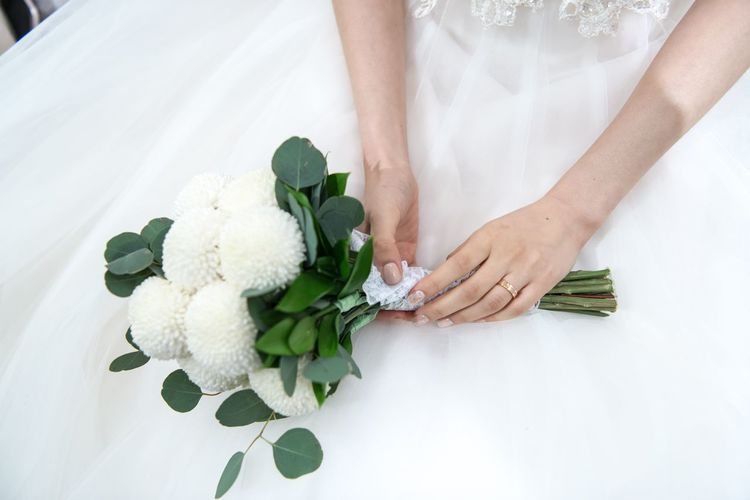Bouquet Bride Bridegroom Celebration Celebration Event Ceremony Couple - Relationship Flower Groom Holding Human Hand Indoors  Life Events Love Married Men New Life Real People Togetherness Wedding Wedding Ceremony Wedding Dress White Color Wife Women