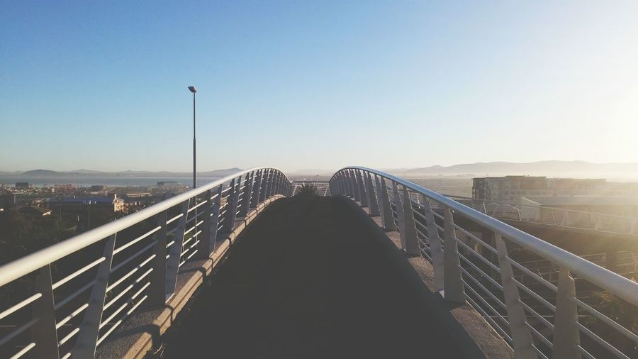 Architecture Blue Sky Bridge Clear Sky Clear Sky Diminishing Perspective Footbridge Outdoors Railing The Way Forward Walkway The Great Outdoors With Adobe The Following