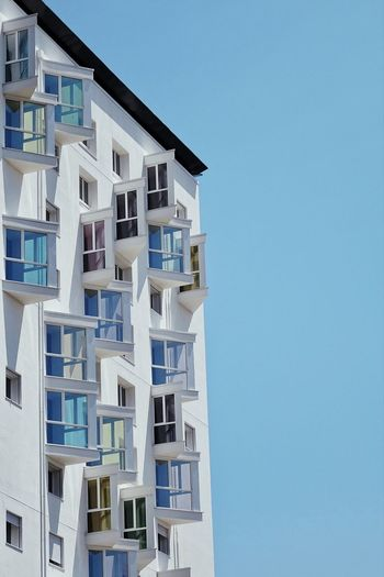 Low angle view of residential building against clear sky