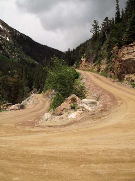 Dirt road traveling Cloudy Curve Dirt Road Long Mountain Mountain Road Narrow Nature Outdoors Peaceful Remote Rocky Mountains Scenics Solitude Tranquility Tree