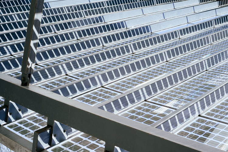 Detail view on metal and glass roof construction with solar panels