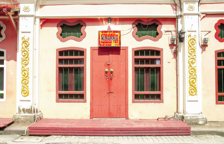 The image of the old Sino Portuguese architecture shows the design of the window from China, which is located in Phuket, Thailand. Architecture Phuket,Thailand Sunlight Architecture Building Building Exterior Built Structure China City Communication Day Decoration Door Entrance House Impact No People Old Buildings Outdoors Represents Sign Sino-portuguese Architecture Street Window