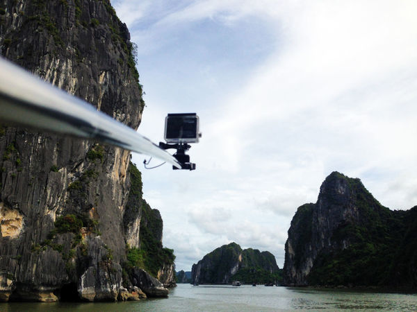 filming with GoPro at boat cruise at Halong Bay, Vietnam Backpacking Bay Beauty In Nature Boat Cruise Cliff Day Gopro Goprohero4 Halong Bay  Halong Bay Vietnam Mountain Nature No People Outdoors Rock - Object Rock Formation Sea Sky Stick Transportation Tree Water