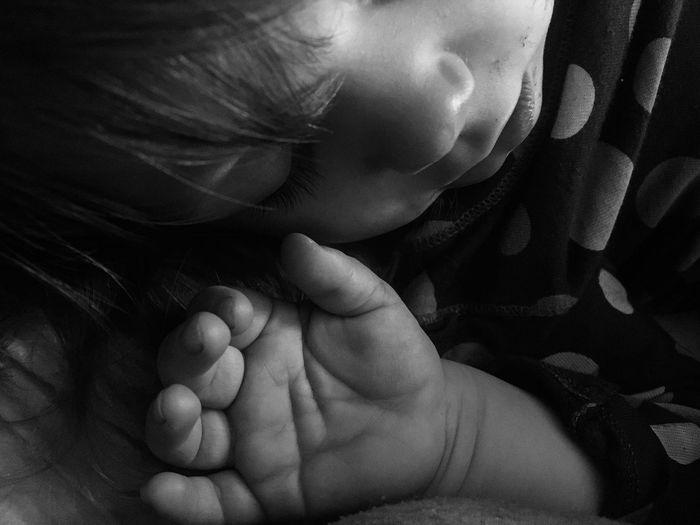 A toddler sleeps Babyhood One Person Real People Childhood Indoors  Fragility Human Hand Close-up Baby Sleep sleepy Innocence peacefully parents Human Body Part