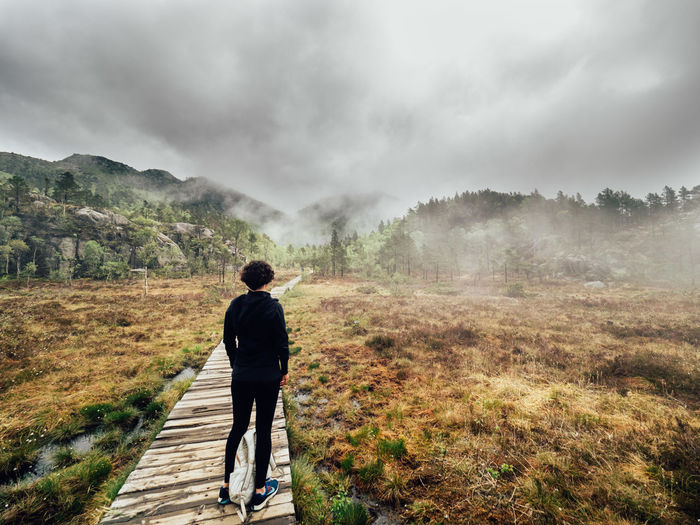 Lost In The Landscape Norway Beauty In Nature Cloud - Sky Day Full Length Landscape Leisure Activity Lifestyles Mountain Nature No People One Person Outdoors People Real People Rear View Scenics Sky Tranquility Tree