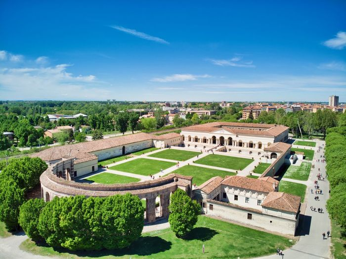 Italy, Mantua: Palazzo Te Scenics Landascape Aerial View Drone  Outdoors Day Daylight Daytime Sunny Unrecognizable People Unesco UNESCO World Heritage Site Architecture Renaissance Palace Palazzo Italianate Green Color Color Green History Travel Travel Destinations Travel Destination Sky Plant Grass Nature Built Structure Cloud - Sky Tree Landscape Building Exterior City Building Environment Landscaped Scenics - Nature Beauty In Nature Hedge Ornamental Garden Luxury