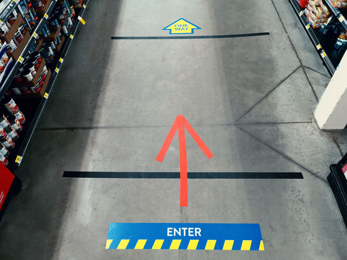 Tape lines on store floor for maintaining physical distancing.