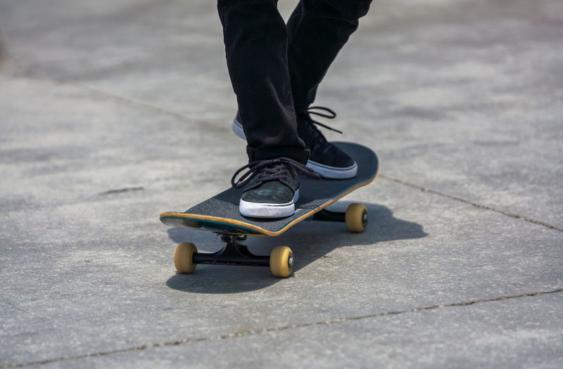 Closeup of skateboarder feet Low Section Human Leg Body Part Skateboard Shoe One Person Motion Real People Balance Human Body Part Leisure Activity Lifestyles Street City Unrecognizable Person Human Foot Outdoors Jeans Skill  Los Angeles, California The Street Photographer - 2019 EyeEm Awards