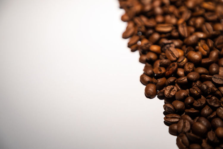 fresh roasted coffee beans Abundance Brown Caffeine Close-up Coffee Coffee - Drink Copy Space Drink Food Food And Drink Freshness Heap Indoors  Large Group Of Objects No People Roasted Roasted Coffee Bean Selective Focus Still Life Studio Shot Textured Effect White Background