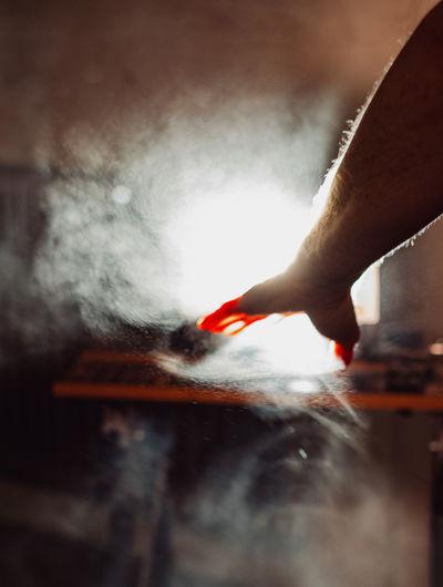 Close-up of hand holding smoke