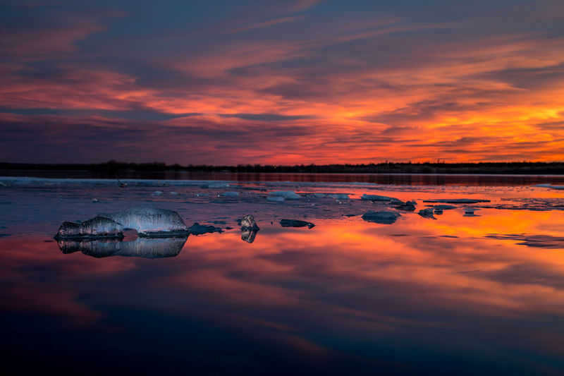 A small iceberg reflecting the gorgeous sunset at Cherry Creek State Park. Dramatic Sky Reflection Sunset_collection Beauty In Nature Cloud - Sky Day Iceberg Lake Nature No People Orange Color Outdoors Reflection Salt - Mineral Scenics Sharp Shoreline Sky Sunset Tranquil Scene Tranquility Water
