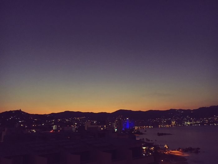 No soy de aquí ni soy de allá Mar Sunset Night Architecture Illuminated City No People Built Structure Beauty In Nature Building Exterior Scenics Sky Cityscape Outdoors Nature Sea Water