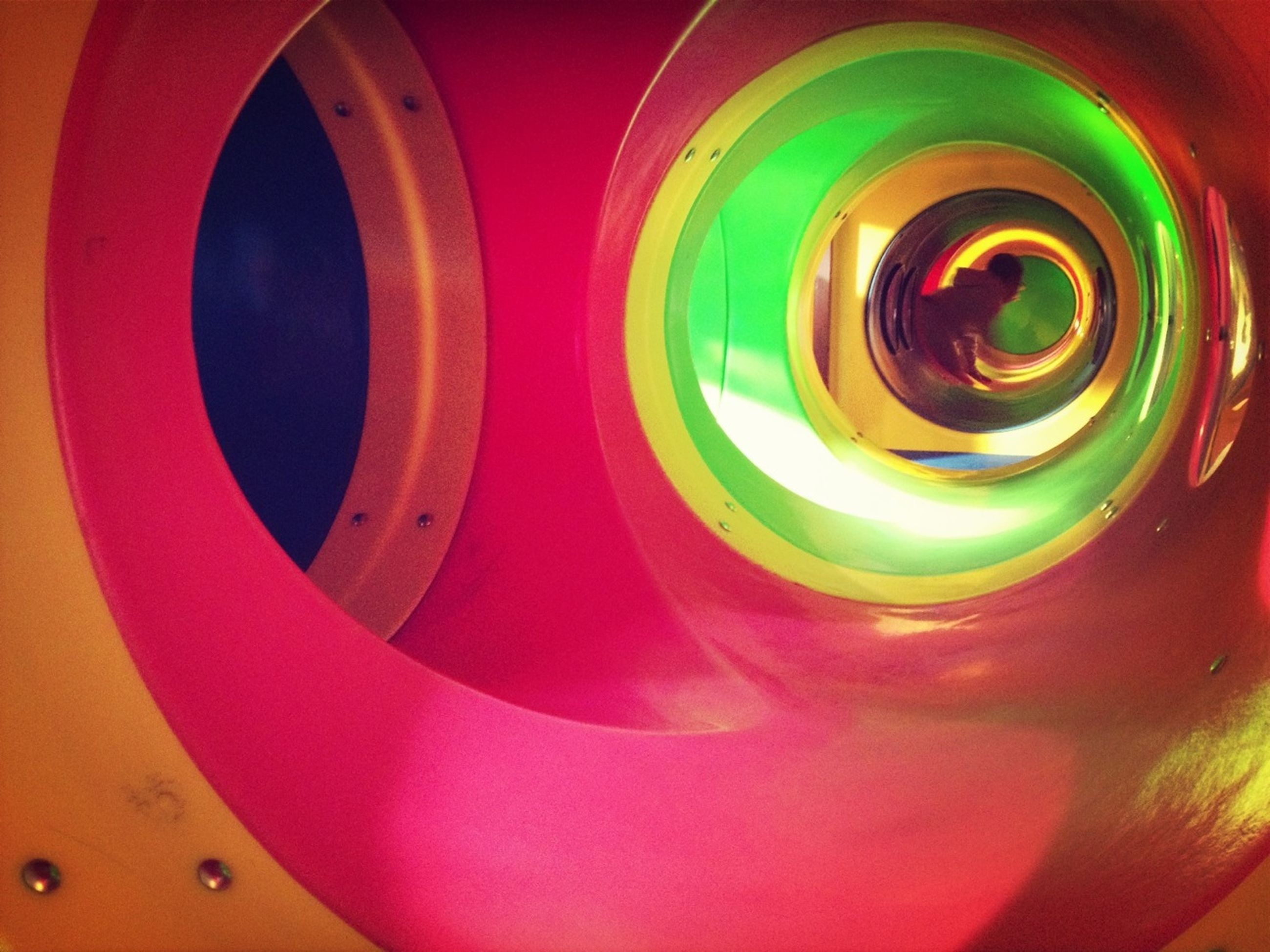 multi colored, indoors, pattern, circle, abstract, creativity, art and craft, design, full frame, art, backgrounds, red, close-up, colorful, geometric shape, shape, spiral, illuminated, no people, decoration
