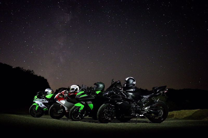Motorcycle against sky at night