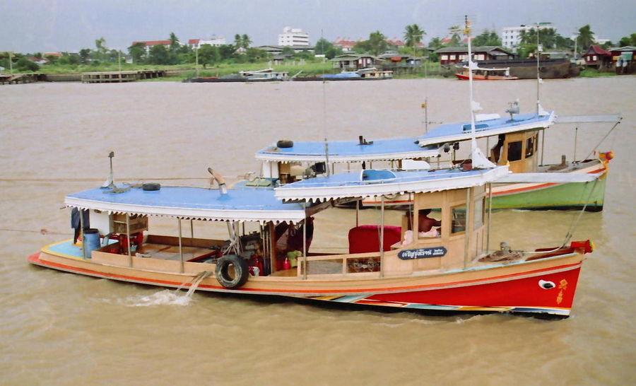 Two River Tug Boats pulling Rice Barges Bangkok Boat Business Colourful Composition Culture Mode Of Transport Motor Boat Nautical Vessel No People Outdoor Photography River River Bank  Thailand Tourism Tourism Malaysia Tourist Attraction  Tourist Destination Trade Transportation Trees Tugboat Two Underway Water