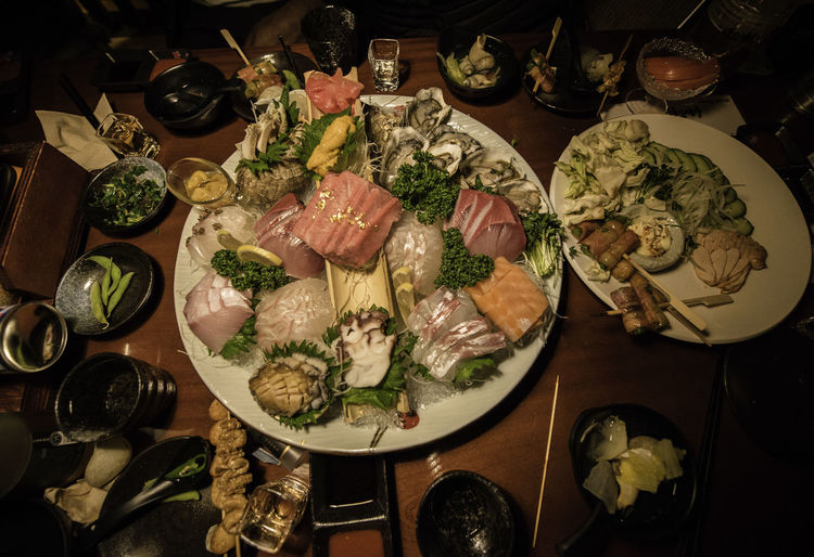 Japanese Izakaya Wellbeing Food And Drink Food Healthy Eating Freshness Seafood Plate Table High Angle View Top Down View Japanese Food Izakaya Restaurant Meal Fish Oyster  Sashimi  Nightout Asian Lifestyle Asian Foods Indoors  Night