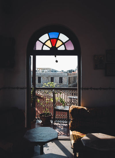 Window to the city Arch Architecture Building Built Structure Chair Day Furniture Glass - Material Indoors  No People Seat Spirituality Sunlight Table Window