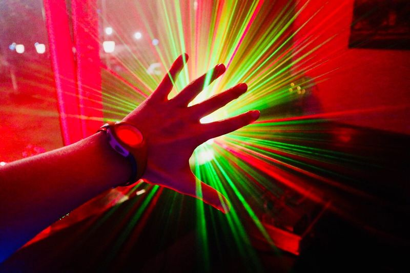 Trippy Human Hand Human Body Part One Person Human Finger Multi Colored Red Indoors  Fanned Out Young Adult Palm Disco Lights Real People Close-up Day