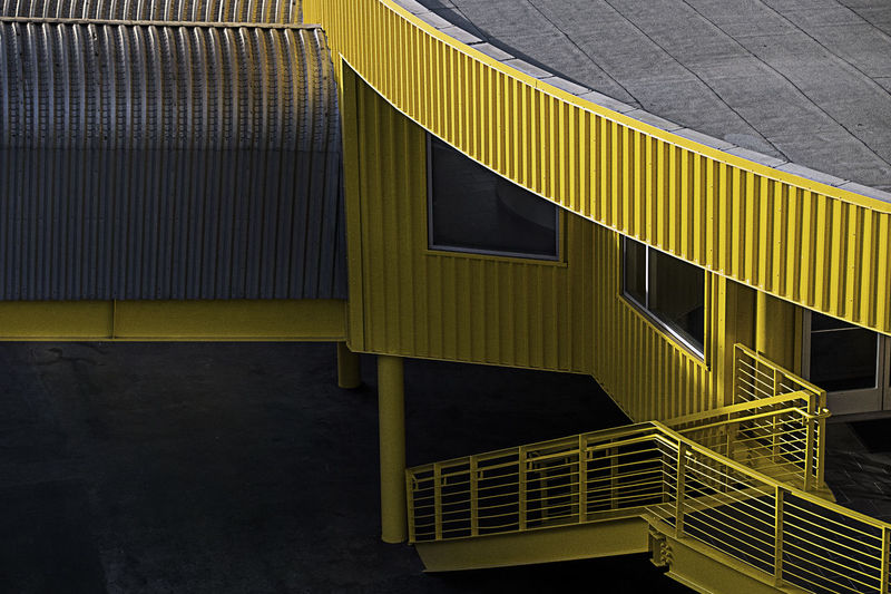 Architecture Built Structure Building Exterior Yellow Building Pattern No People Modern Day Outdoors City Metal Wall - Building Feature Railing Staircase Residential District Design High Angle View Window Silver Colored Parking Garage Apartment Corrugated Urban