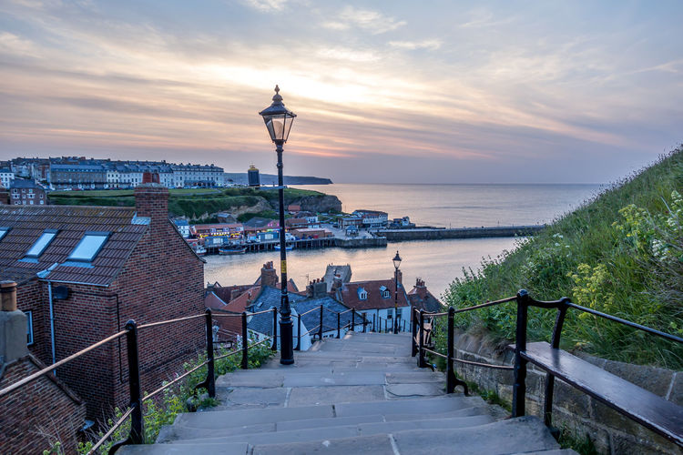 Whitby Whitby Harbour Whitby View Whitby North Yorkshire North Yorkshire North Yorkshire Coast Seaside Seaside Town Coastal The Way Forward Sky Water Railing Sunset Horizon Travel Destinations Horizon Over Water Street Light Outdoors Built Structure Sea Architecture Building Exterior Cloud - Sky No People