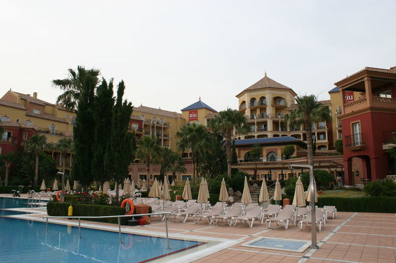 RIU Ferrara Hotel 2009 (renamed to IBEROSTAR Malaga Playa in 2011) - Pool and Garden Architecture Building Exterior Built Structure Chair Day Hotel Pool Hotel View Iberostar IBEROSTAR Malaga Playa Luxury No People Outdoors Palm Tree Palm Trees Riu Hotel Sky SPAIN Swimming Pool Tourism Tourist Resort Travel Destinations Tree Vacations Water