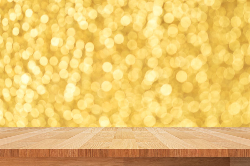 Backgrounds Bright Brightly Lit Celebration Christmas Christmas Lights Copy Space Decoration Defocused Empty Event Glitter Holiday Illuminated Indoors  Lighting Equipment New Year's Eve No People Pattern Shiny Wood - Material Yellow