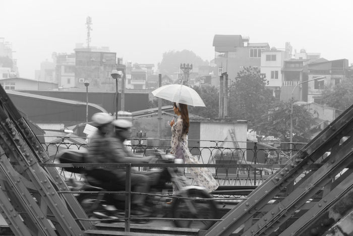 Woman walking on a bridge Transportation Umbrella Cityscape Vietnam Hanoi Blackandwhite Bridge Rain Bride