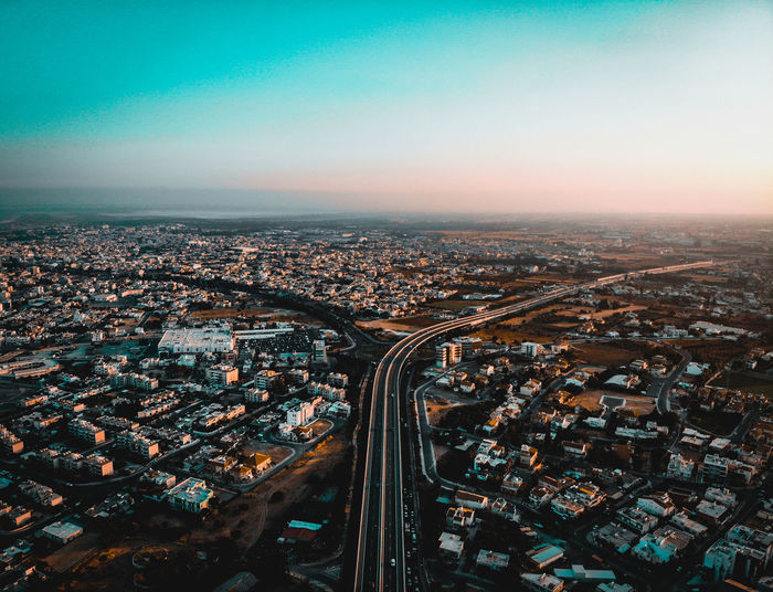 Highway Urbanarchitecture Urbanana: The Urban Playground Dji Mavic Air Above View Golden Hour EyeEmNewHere Limassol City Cityscape Highway Road Buildings City Cityscape Urban Skyline Skyscraper Aerial View Airplane Illuminated Sunset Sky Architecture Crowded TOWNSCAPE Urban Scene Downtown Residential District Town