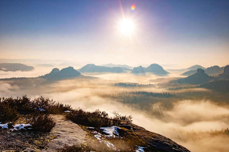 Beautiful panoramic view at sandstone rocks during foggy sunrise, saxon switzerland germany