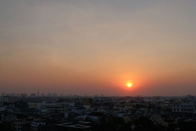 High angle view of townscape against sky during sunset