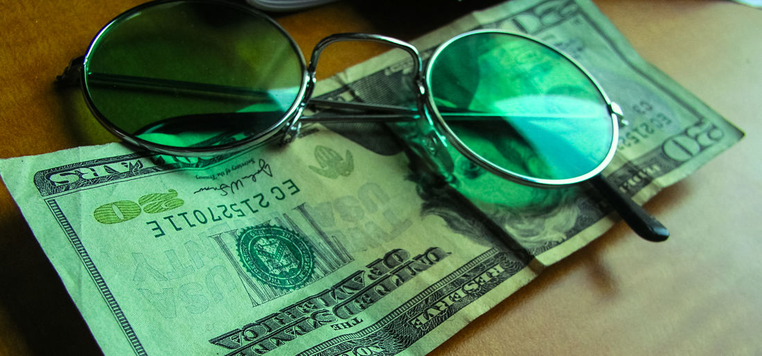 Glasses Sunglasses Eyeglasses  Close-up Finance Fashion Still Life No People Indoors  Security Protection Glass - Material Personal Accessory Table Currency Focus On Foreground Green Color Paper Currency Communication Safety