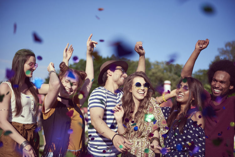 Group of people enjoying at music concert