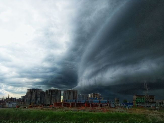 angry sky Cityscape Urban Skyline Sky Architecture Building Exterior Grass Cloud - Sky Lightning Storm Extreme Weather Power In Nature Cyclone Tornado Dramatic Sky Rushing