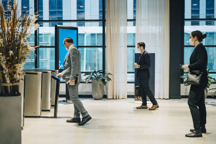 Man and woman walking in building