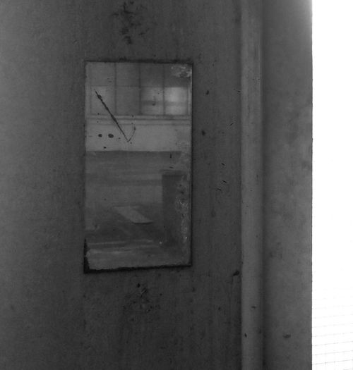 The workers mirror No People Wall - Building Feature Indoors  Architecture Window Built Structure Close-up Glass - Material Old Wall Abandoned Day