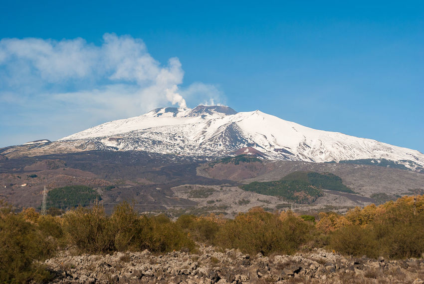 South flank of volcano Etna covered by snow during the winter Active Catania Day Etna Italy Landscape Lava Mountain Nature Nature No People Outdoors Panoramic Plume Scenics Sicily Sky Snow Snowcapped Mountain Sunny Volcano Winter