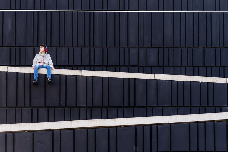 Full length of man working on railing